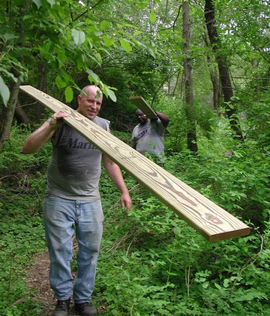Swamp-Hut-carrying-in-materials