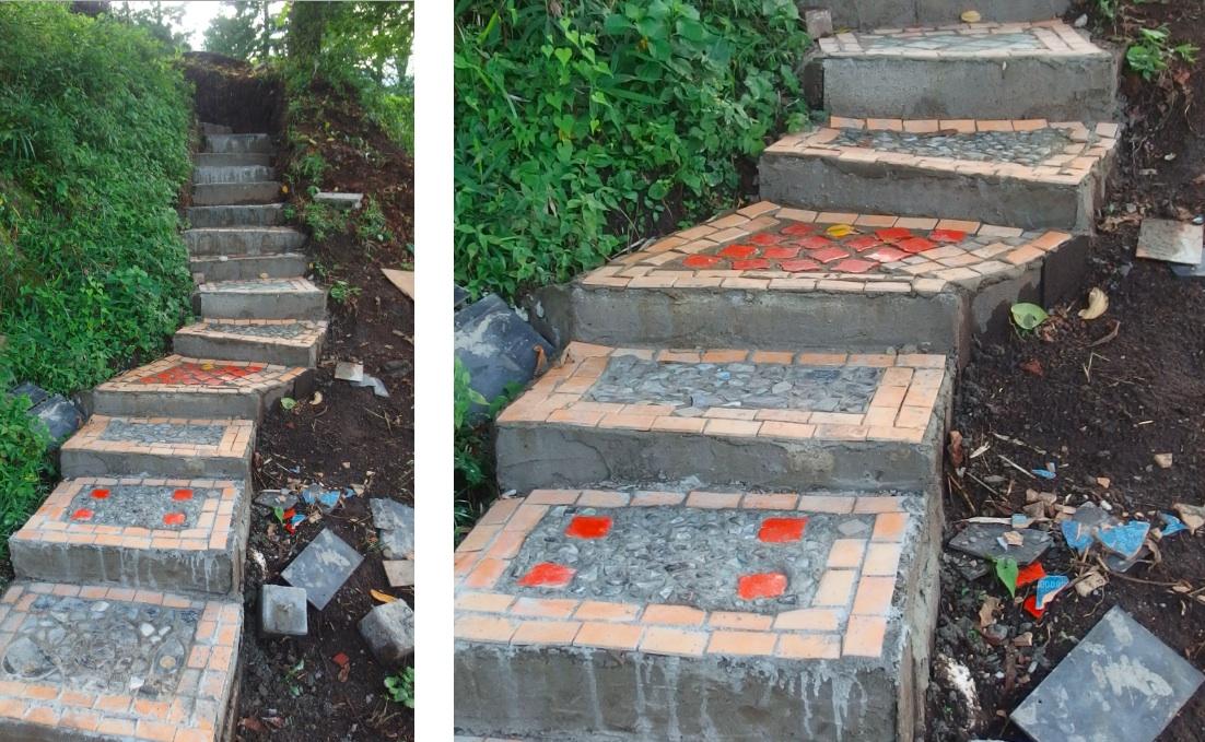 崖を削りコンクリートを流し込んで作った階段。タイルの模様に遊び心がある